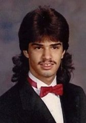 A mullet can compliment a mustache rather well